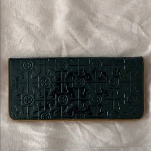 Tory Burch black with brown inside clutch